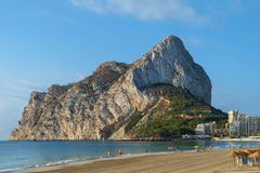 Calpe Rock, Ifach, and Calpe town seen from one of the beaches north of the town, Costa Blanca, Spain. Royalty Free Stock Photography