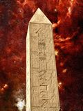 Monolith in the temple of Karnak and infrared Galactic Center (E Royalty Free Stock Image