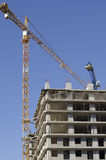 Monolithic house and crane Stock Images