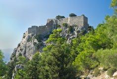 Monolithos castle on Rhodes island, Greece. Monolithos castle on cliff on Rhodes island, Greece Stock Photos