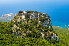 Monolithos Castle Rhodes. Overlooking the Venetian Castle at Monolithos built in 1480 by the Knights of Saint John, Rhodes Greece Europe royalty free stock photography