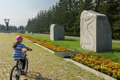Monoliths of granite on the Road of War with carved years and military episodes. Park of Culture and Rest named after. Omsk, Russia - June 21, 2016: Monoliths of Stock Photos