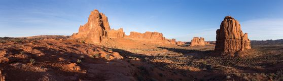 Panorama of Monoliths in Arches National Park Utah. These Monoliths make a dramatic stand in the early morning Utah sunshine royalty free stock photo