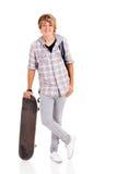 Monopatín del muchacho del adolescente Foto de archivo libre de regalías