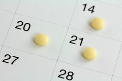 Monophasic Birth Control Pills on a Calendar Royalty Free Stock Photos