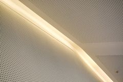 Monophonic background or background in the form of a white covering with illumination and bulbs. Geometry of lines and minimalism. Monophonic background or royalty free stock photo