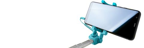 Free Monopod For Selfie With Smart Phone. Selfie Stick With Smartphone Isolated On White Background, Banner Stock Photography - 122254982