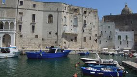 Monopoli, Italy - August 4, 2017: harbor of Monopoli city with the old town and boats, Apulia, Italy.  stock video footage