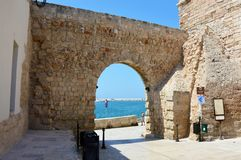 MONOPOLI, ITALY - AUGUST 4, 2017: view of arch of the castle in Monopoli, Apulia region, Italy.  Stock Images