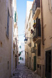 Monopoli, Puglia, Italy - beautiful alley. Monopoli, Puglia, Italy - beautiful sunny alley with lanterns Royalty Free Stock Photos