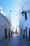 Monopoli, Puglia, Italy - beautiful alley. Monopoli, Puglia, Italy - beautiful white sunny alley Royalty Free Stock Photography