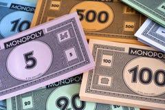 Monopolu pieniądze paczki pełny ramowy makro pizza strzał Zdjęcia Stock