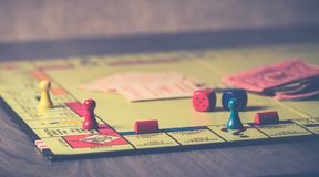 Monopoly Board Game on Brown Wooden Tabletop royalty free stock photo