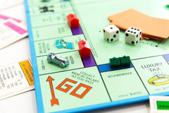 Monopoly board game in play. Monopoly board game cards and pieces Royalty Free Stock Photo