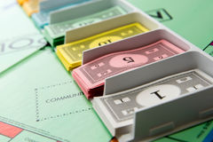Monopoly board game in play Royalty Free Stock Photo