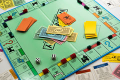 Monopoly board game in play. Monopoly board game cards and pieces Stock Photography