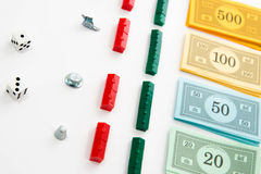 Monopoly board game in play Royalty Free Stock Image