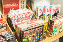 Monopoly Game For Sale On Library Shelf Stock Photo