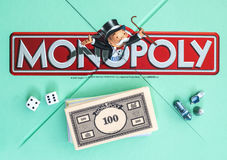 Monopoly. SWINDON, UK - JUNE 11, 2014: English Edition of Monopoly showing The Logo,  The classic trading game from Hasbro was first introduced to America in Stock Image