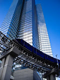 Monorail at foot of tall modern Building Stock Images