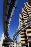 Monorail skyscrapers. Futuristic monorail going around skyscrapers. Wide angle view Stock Image