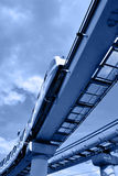 Monorail train. High speed monorail train on overpass toned in blue color Royalty Free Stock Images