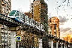 A monorail train runs above the street in Moscow Royalty Free Stock Image