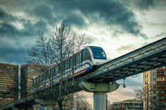 A monorail train runs above the street in Moscow Royalty Free Stock Photography