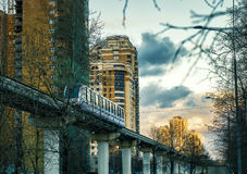 A monorail train runs above the street in Moscow Royalty Free Stock Images