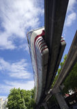 Monorail Transit Train Travels Over Neighborhood Carrying People Stock Photo