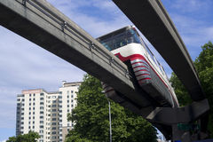 Monorail Transit Train Travels Over Neighborhood Carrying People Stock Photography