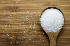 Monosodium glutamate (MSG) in wood spoon. Close up of Monosodium glutamate (MSG), a flavor enhancer in many asian food Stock Image