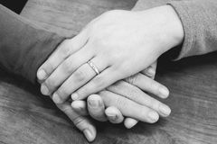 Monotone close up hands of Mom and daughter royalty free stock images