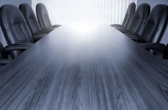 Monotone conference table. Empty boardroom table with chair for at least six royalty free stock photo