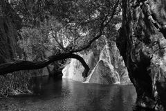 Monotone of small pond and waterfall in Death Valley. National Park stock image