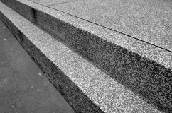 Monotone steps on a street. Monotone steps on a street with rust sand texture in perspective view stock photo