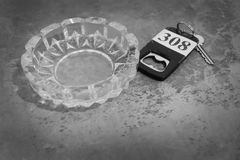 Monotone style background. ashtray and room key 308 . Monotone style background. ashtray and room key 308 and empty space for text stock image