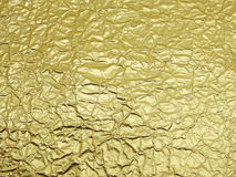 Monotone texture of the golden foil. Royalty Free Stock Photography
