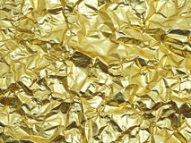 Monotone texture of the golden foil. Stock Photography