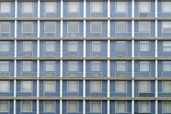 Monotonous facade. Symmetrical facade windows full of the same Royalty Free Stock Photography