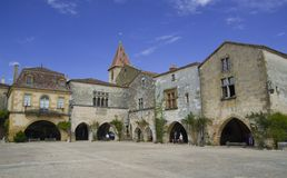 MONPAZIER, FRANCE - SEPTEMBER 10, 2015: Main square in the bastide of Monpazier, Dordogne, France, September 2015 stock photos