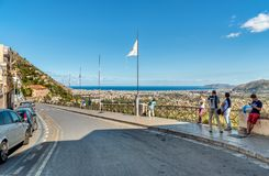 People enjoying panoramic view over Palermo and mediterranean sea coast from the Monreale City. Stock Photography