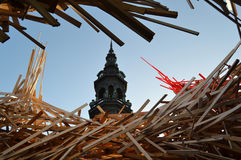 Mons City Hall tower and art installation. Mons, Belgium - December 31, 2015 : The Passenger by Arne Quinze. Controversial contemporary work of art installed Stock Images