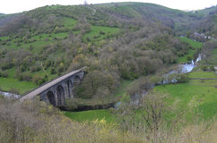 Monsal Head Viaduct, Derbyshire. England, originally built for trains but now part of a walking route in Peak District National Park, with trees and moorland Stock Photos