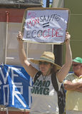 Monsanto Equals Ecocide GMO Protest Sign Stock Images