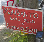 Monsanto, Evil Seed of Corporate Greed Sign Royalty Free Stock Photos