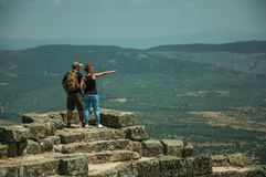 Couple looking the landscape from wall of Castle. Monsanto, Portugal - July 13, 2018. Couple looking the countryside landscape from stone wall at the Castle of royalty free stock photos