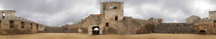 Monsaraz Castle 360 degrees. 360 degrees image of Monsaraz Castle interior spacer, used as a bullfighting arena, under an overcast sky. Portugal Royalty Free Stock Images