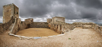 Monsaraz Castle interior view. Monsaraz Castle, used as a traditional bullfighting arena, under an overcast sky. Portugal Stock Photos