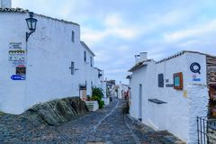 Alley in Monsaraz. MONSARAZ, PORTUGAL - DECEMBER 30, 2017: View of an alley in the historic village, with local businesses, in Monsaraz, Portugal Stock Images